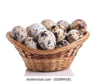 quail eggs in basket isolated on white background