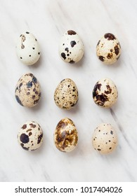 Quail eggs on a marble background