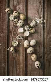 Quail eggs on an old vintage dark wooden background. Country style. View from above. Selective focus. Still life with quail eggs.