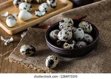 Quail eggs on wooden table background