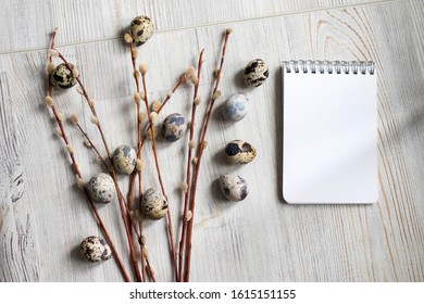 quail eggs with willow on the table. Easter decoration of the kitchen