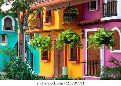 Quaint building facade in Puerto Vallarta Mexico with traditional bright colors.