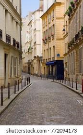 A quaint, deserted cobbblestone street in Paris.