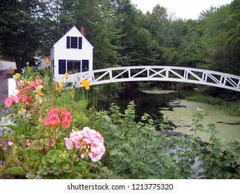 Quaint house by Somes Pond Maine with arched walking bridge