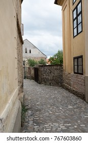 Quaint little cobblestone side street in the city of Kutna Hora, Czech Republic.  Old historic houses and a cobbled street in a small European city, no people, local vernacular architecture.