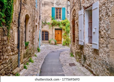 A quaint narrow lane running through the medieval area of Vaison la Romaine, a village in the Vaucluse region of Provence, France.