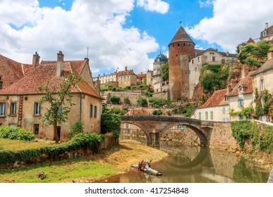 Quaint river through the medieval town of Semur en Auxois, Burgundy, France