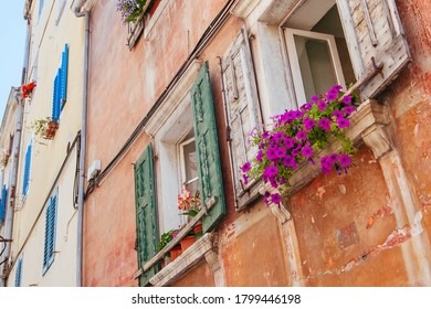 Quaint streets and flowers on a hot summer's day in the iconic town of Piran in Slovenia