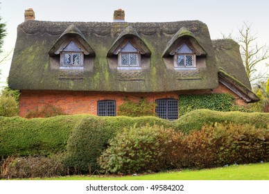 A quaint thatched cottage in an English village