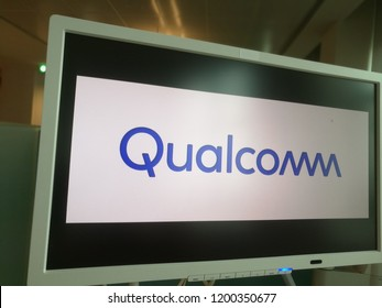 Qualcomm Company Name Logo on a PC Monitor in a Coworking Place in Milan,Italy-October 2018
