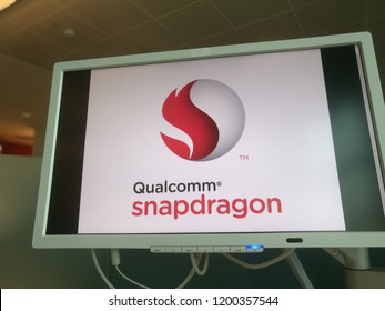 Qualcomm Snapdragon Processor Company Name Logo on a PC Monitor in a Coworking Place in Milan,Italy-October 2018