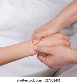Qualified therapist doing deep tissue wrist massage