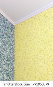 A qualitative transition from blue to yellow liquid wallpaper in the corner of the room
