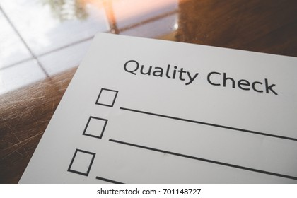 Quality check paper and the format for filling in information in business concept,vintage style and softtone