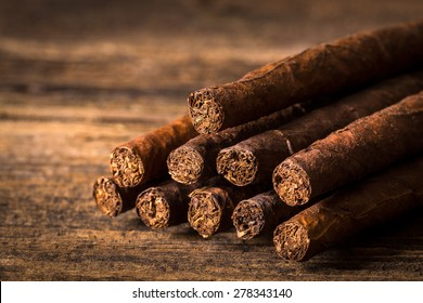 quality cigars for relaxing on an old wooden table