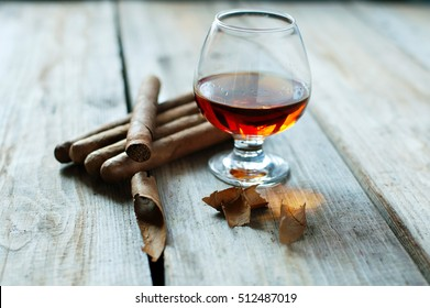 quality cigars and whisky  on an old wooden table