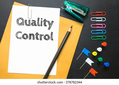 Quality control, message on the white paper / business concept