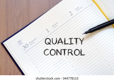 Quality control text concept write on notebook with pen