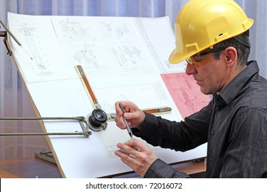 The quality dimensional inspector/engineer checking metal components.