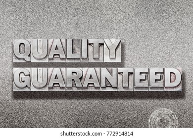 quality guaranteed phrase made from vintage letterpress on metallic textured background