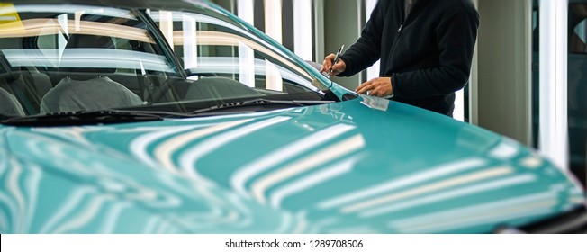 The quality inspector is checking the production of the off-line car body