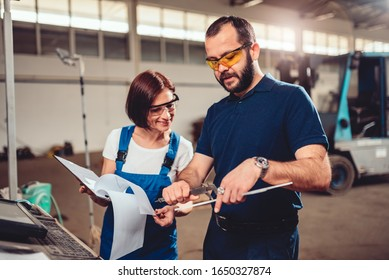 Quality inspector checking products measurements made by CNC machine operator