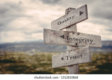 Quality, integrity, trust signpost in nature. Guidance, corporate, employee, honesty, business, company, team building concept.