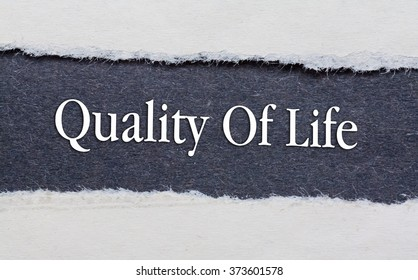 Quality of life words under torn black paper.