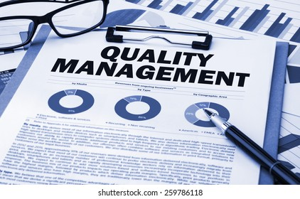 quality management concept on clipboard