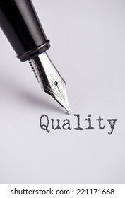 Quality with pen written on paper