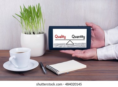 Quality and Quantity Balance. Digital tablet computer with isolated screen in male hands