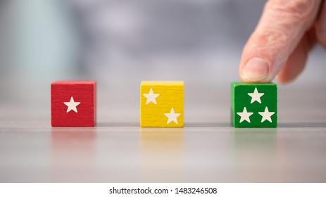 Quality rating concept with wooden cubes