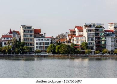 Quan Tay Ho or Westlake district in Hanoi. Bank of lake Tay with residential buildings and restaurants. Vietnam.