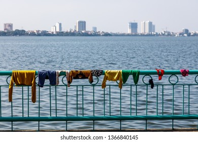 Quan Tay Ho or Westlake district in Hanoi. Bank of lake Tay with drying laundry over the railing and view of the city. Vietnam.