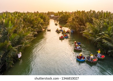 QUANG NAM, VIETNAM - FEB 12, 2019: Aerial view, tourists from China, Korea, America, Russia experiencing a basket boat tour at the coconut water ( mangrove palm ) forest in Hoi An, Quang Nam, Vietnam