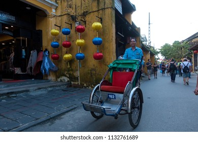 Quang Nam, Vietnam - MAY 2018: The cyclos in Hoi An old town. Stock photo of cyclo on street, cyclo is the favorite transportation in Hoi An. HoiAn ancient town is one of the most popular destination