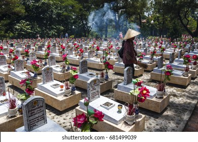 """QUANG TRI, VIETNAM - JUL 14. 2017 - The graves of PAVN soldiers killed on the 17th parallel north DMZ and on the Tr??ng S?n """"Long Mountain"""" Annamite Range Trailat at The Truong Son Martyrs' Cemetery"""