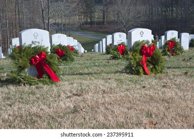 QUANTICO, VA-DEC 13, 2014: Quantico National Cemetery wreath laying event on Dec 13 Wreaths Across America , a non profit organization,  placed wreaths after a brief ceremony.
