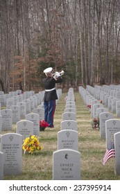 QUANTICO, VA-DEC 13, 2014: Quantico National Cemetery wreath laying event on Dec 13. Wreaths Across America , a non profit organization, placed wreaths after a ceremony that included the playing of taps