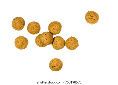Quantity of scattered Pepernoten cookies from above as Sinterklaas decoration on white background for dutch sinterklaasfeest holiday event on december 5th