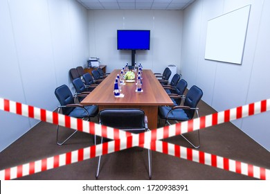 Quarantine Cancellation. Fence tape at the entrance to the meeting room. Striped ribbon symbolizes the ban on the event. Concept - meeting is canceled. Concept - cancellation due to social distance