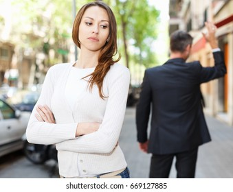 Quarrel between loving couple strolling on city streets