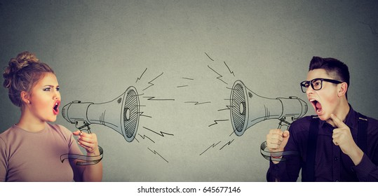 Quarrel between woman and man screaming at each other in megaphone
