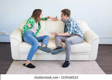 Quarrel, conflict and people concept - Woman making gesture while quarreling with her partner in the living room