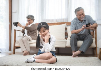 In quarrel elderly mother grown up daughter sit on couch separately having conflict, intergenerational misunderstanding, adult grandchild grandma difficult bad relations different generations concept