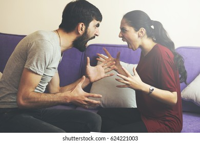 Quarrel  woman  and man  sitting on sofa