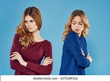 quarreled girlfriends on a blue background
