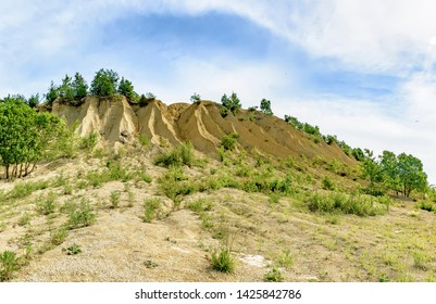 Quarries for the extraction of limestone. A mound formed by small piles of crushed limestone and washed away by rains.