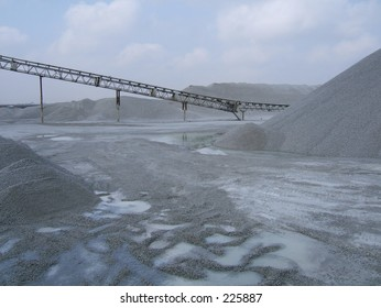 quarry conveyor belt with mounds of stones