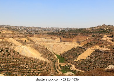 Quarry, olive groves and vineyards near the city of Hebron, Israel